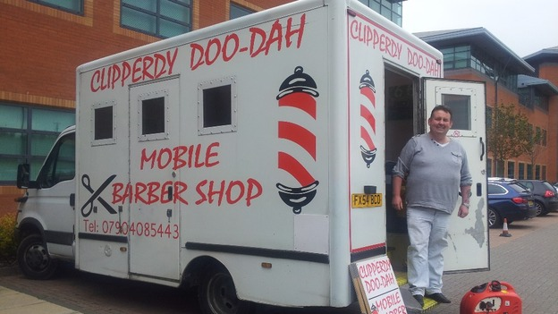Stewart vine outside his mobile barber shop credit itv tyne tees