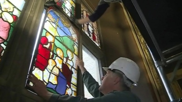 Experts removing stained glass window