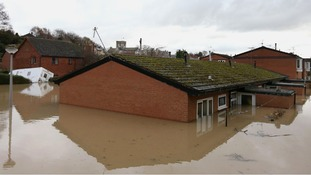 Flood waters come close to covering houses in St. Asaph, Denbighshire