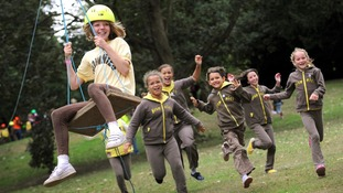 Brownies enjoy the zip-wire activity at the Girl Guiding UK's Centenery celebration