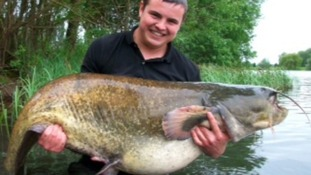 Daniel Sibley with his 8 stone fish in Northamptonshire.