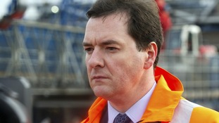 George Osborne on a building site as discussion about whether the construction figures have too much influence