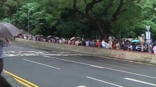Dozens of protester gathered outside the US Embassy in Hong Kong.