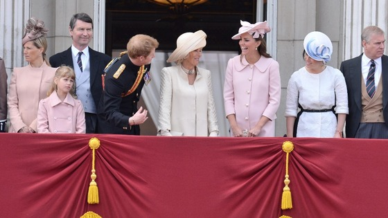 Prince Harry talks to the Duchess of Cornwall and Duchess of Cambridge on the balcony at Buckingham Palace.