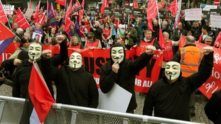 Anti G8 protesters wearing Guy Fawkes masks