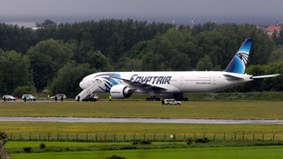 Police surround the Egyptair aircraft