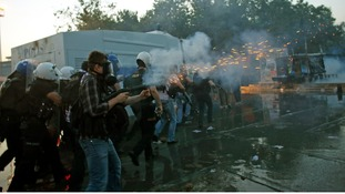 Police fire tear gas cannisters in Istanbul's Taksim Square