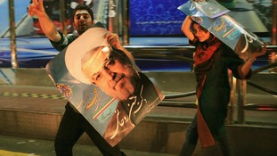 Supporters of moderate cleric Hassan Rouhani celebrate his victory in Iran's presidential election.