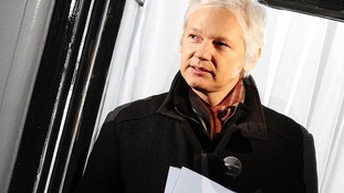 Julian Assange pictured on the balcony of the Ecuadorian Embassy in London in December last year.