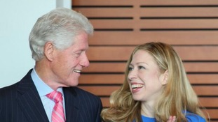 Former US President Bill Clinton with daughter Chelsea