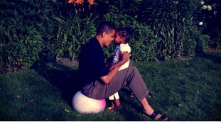 US President Barack Obama with one of his daughters