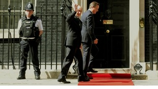 Russian President Vladimir Putin waves as he enters Number 10