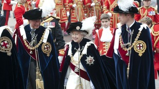 The Queen walks with Prince Charles and Prince William