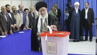 Ayatollah Ali Khamenei casts his ballot in the election