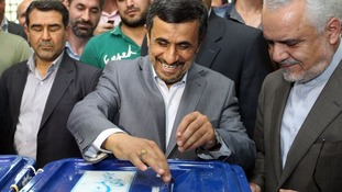 Mahmoud Ahmadinejad casting his ballot in the first round of the presidential elections