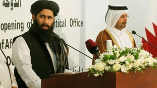 Muhammad Naeem (left) spokesman for the Office of the Taliban speaks during the opening of the Taliban Afghanistan Political Office in Doha.