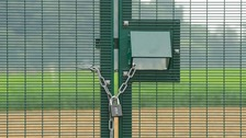 Security at the site of a genetically modified crop trial at Rothamsted Research, in Harpenden, Hertfordshire
