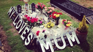 Flowers decorate Maria's grave