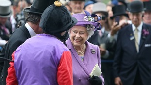 Queen Elizabeth II with winning jockey Ryan Moore, after winning the Gold Cup during Ladies' Day at Royal Ascot