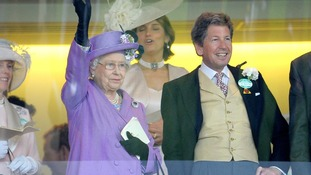 The Queen waves after her horse, Estimate, won the Gold Cup on day three of the Royal Ascot meeting.