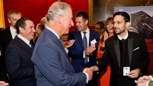 Prince Charles regains his composure to congratulate Dynamo.