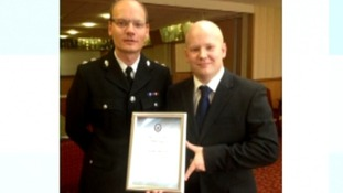 PC Adam Koch with his award, with fellow police officer.