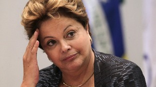 President Dilma Rousseff has postponed her trip to Japan next week, according to Brazil's state television network.