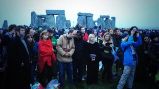 Revellers attempts to see the sun rise at Stonehenge