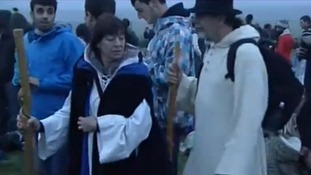 A man and woman in suitable attire at Stonehenge