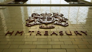 The sign for Her Majesty's Treasury is seen inside the Treasury building in London.