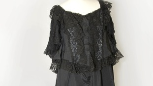 Gown of black silk worn by Queen Victoria.