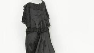 Gown of black silk worn by Queen Victoria.