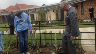 Prince Charles tours the gardens of the Marie Curie Hospice in Solihull, which he opened today.