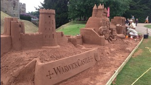 A sand sculptor has created two 10-tonne sandcastles at Warwick Castle.