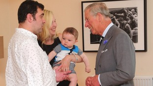 The Prince of Wales meets servicemen Andy Reid, with his wife Claire and son William during a visit to Fisher House UK.
