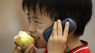 child on a mobile phone