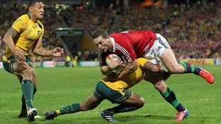 George North is tackled during the match against Australia