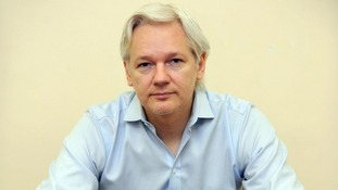 Julian Assange speaks to the media inside the Ecuadorian Embassy in London