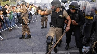 Riot police try to control the demonstrators in Brazil.