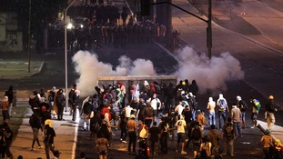 Demonstrators clash with police close to the Mineirao Stadium in Belo Horizonte on Saturday.