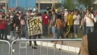 Sign held by protesters reads Fifa Out!
