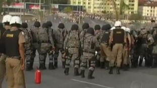 Riot police prevented protesters from getting near the football stadium and fired tear gas