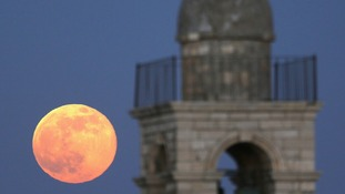 Moon is seen rising behind the Mar Elias Greek Orthodox Monastery in Jerusalem