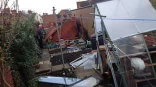 Resident Andrew Sheriff surveys damage to his garden