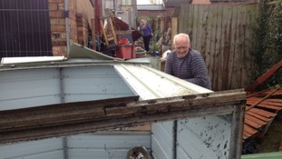 Resident Andrew Sheriff surveys damage