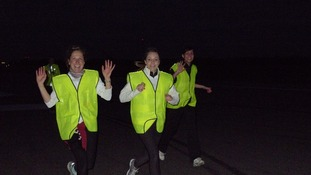 Runners on their early morning charity run at Stansted Airport