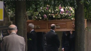The coffin is taken into the Church