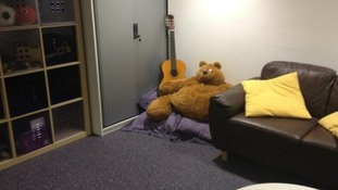 Room with sofa, teddy and guitar