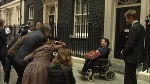 Angela Murray outside Downing Street handing in petition