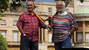 Time Team presenters Tony Robinson (left) and Mick Aston at Buckingham Palace